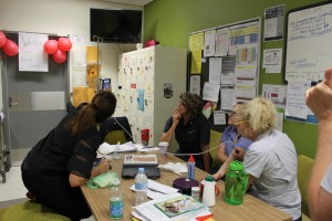 Nambour Hospital nurses learn how to use the portable hand-held ultrasound.