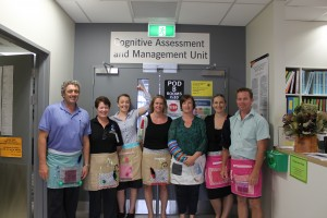 The staff of the CAMU ward model the sensory aprons and sleeves.