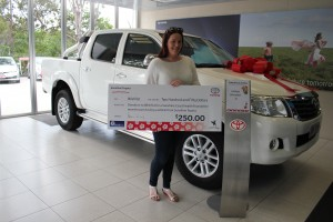 Patient Support Assistant Caitlin Schluter and her new Sunshine Toyota vehicle.
